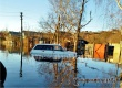 На Мельничной в Аткарске в водном плену оказались машины и скот